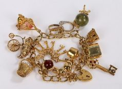 9 carat gold charm bracelet, attached with various charms, 48.1 grams
