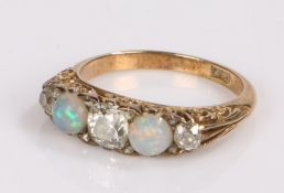 18 carat godl opal and diamond set ring, with two opals and three diamonds, ring size O
