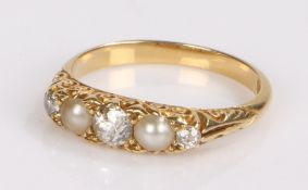 18 carat gold pearl and diamond set ring, with three diamonds and two pearls to the head, ring