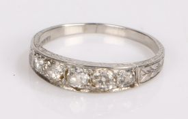 Platinum diamond ring, the head set with five round cut diamonds, ring size Q1/2