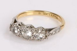 18 carat gold and diamond set ring, with three round cut diamonds to the head, ring size L