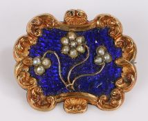 19th Century mourning brooch, with pearl set flowers on an enamel back and scroll frame, locket to