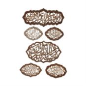 Six Qur'anic plaques, cut-steel with silver overlay [Eastern Ilkhanate provinces, c. 1380]
