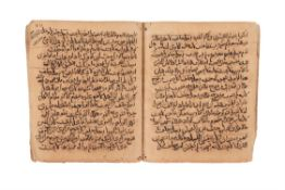 Ɵ Section from Kitab al-Hadi al-Fiqh al-Shafi'i, on paper [Seljuk Persia, mid-twelfth century]