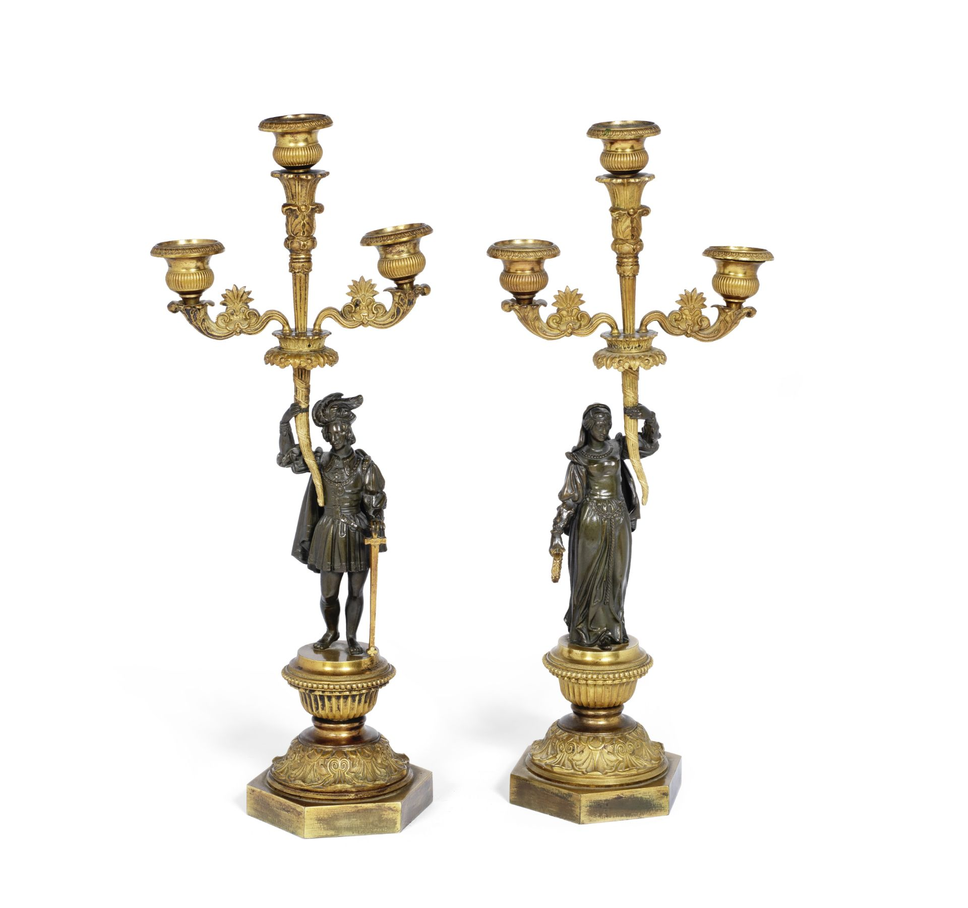 Los 54 - A pair of Louis Philippe gilt bronze figural candlebra in the Troubadour style (2)