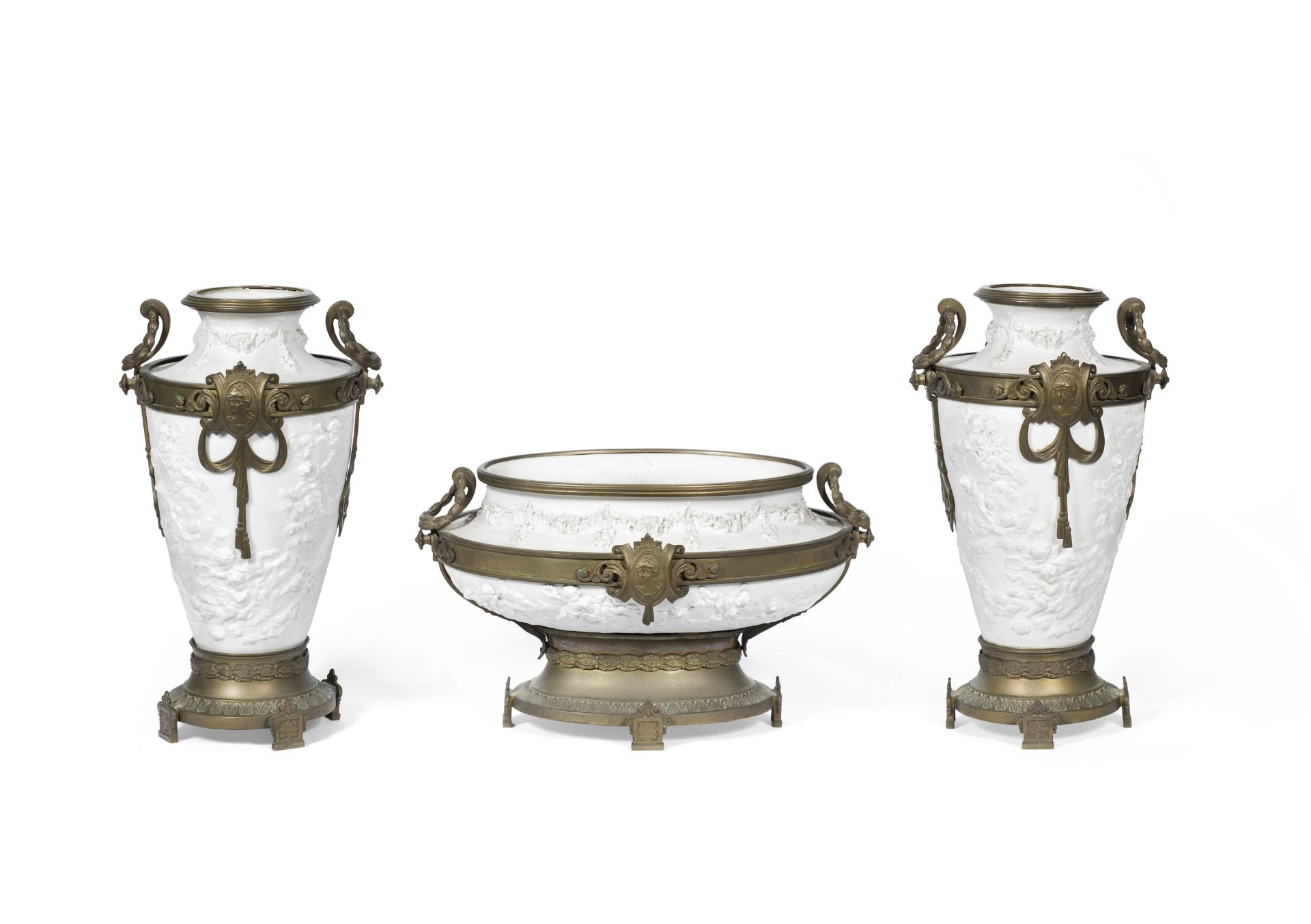 Los 135 - A late 19th / early 20th century Continental bronze mounted biscuit porcelain three piece mantel ...