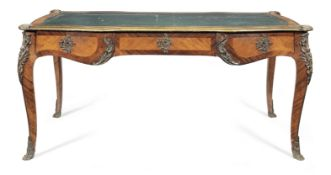 A French late 19th century gilt bronze mounted rosewood and bois satine bureau plat in the Louis ...