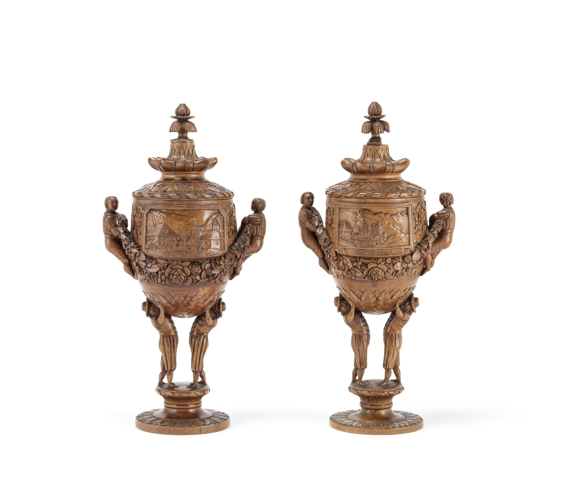 Los 136 - Two similar carved and turned stained lindenwood souvenir cups and covers (2)