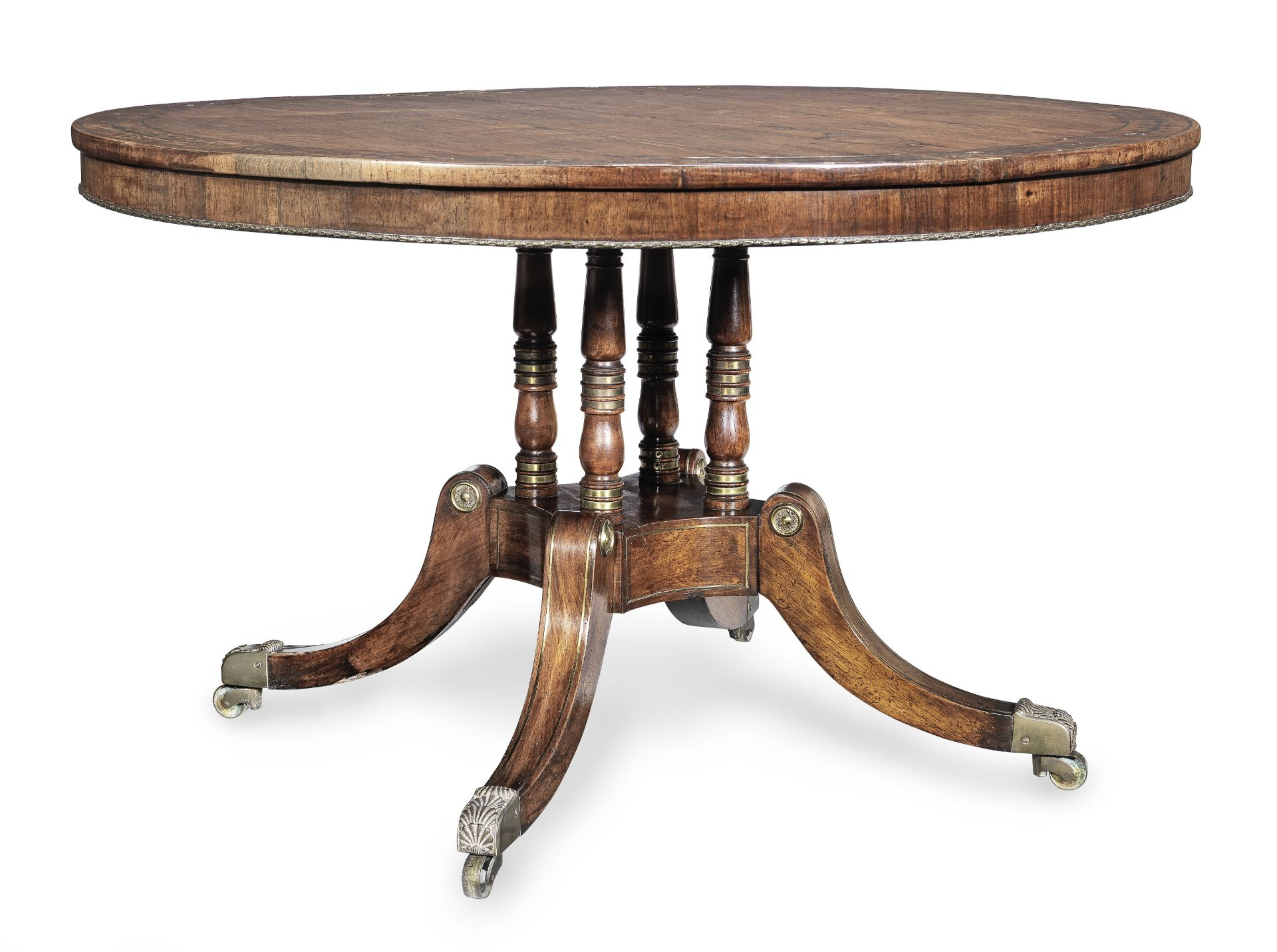 Los 109 - A Regency brass mounted and brass inlaid rosewood breakfast table