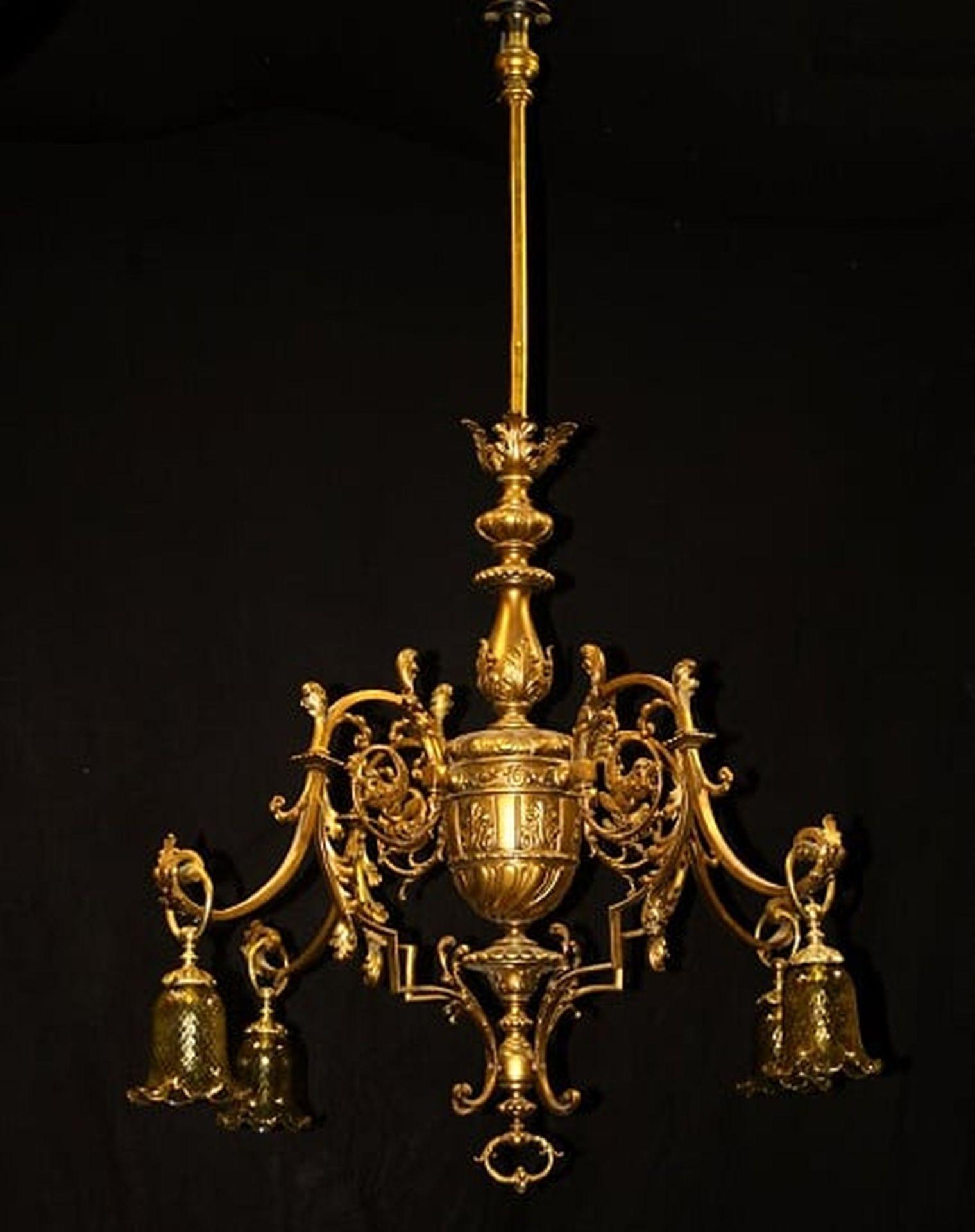 Los 228 - A late 19th century gilt bronze four light gasolier