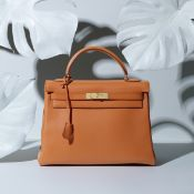 Orange H Swift Kelly Retourne 32, Hermès, c. 1998, (Includes padlock, keys, cloche and shoulder s...