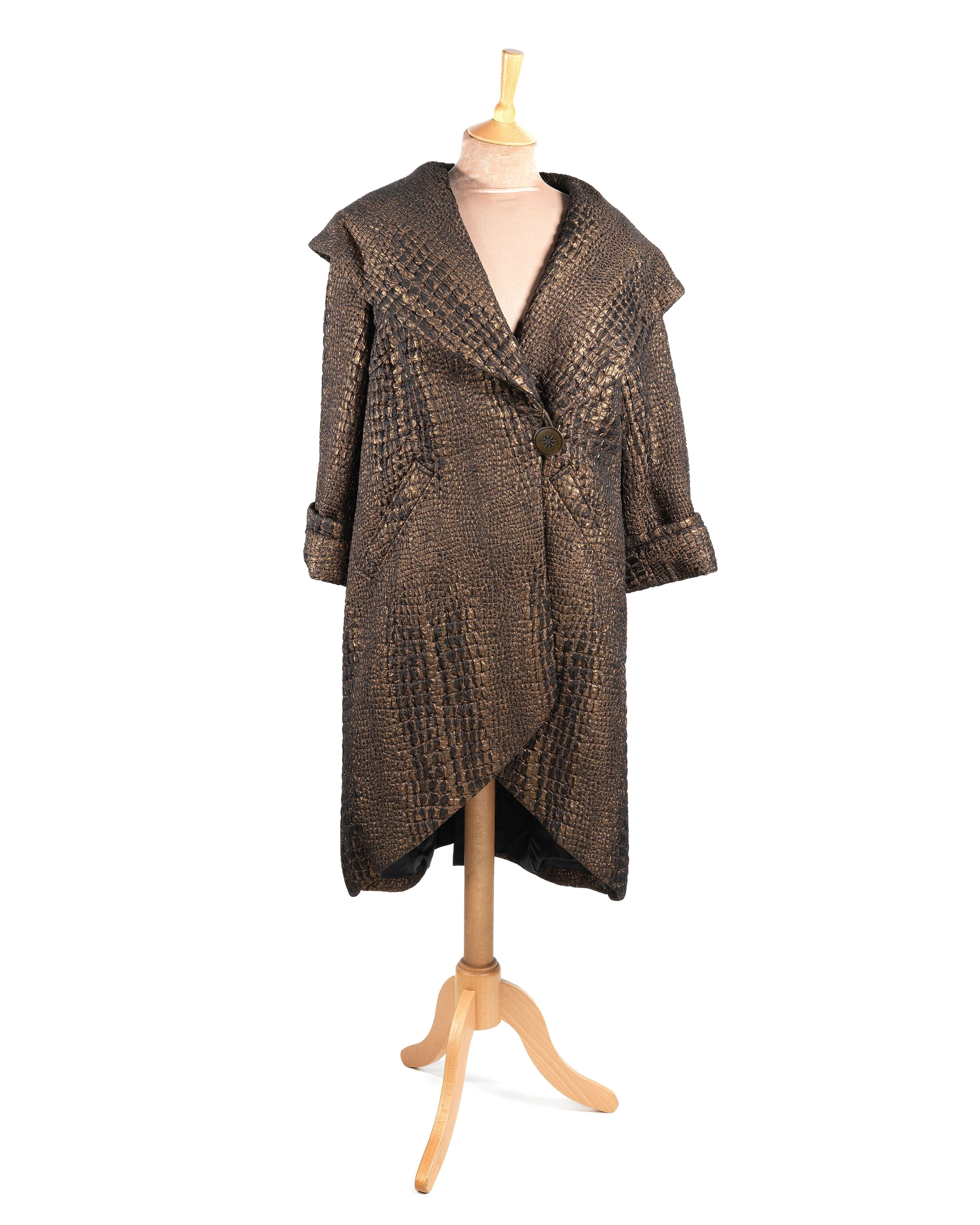 The Children Act: A screen-used bronze brocade evening coat worn by Emma Thompson for her role as...