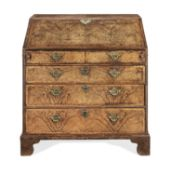 A George II walnut, crossbanded and feather banded bureau