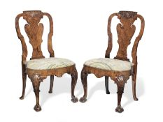 A pair of George I and later walnut chairs