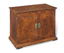 An early 18th century and later walnut veneered table cabinet