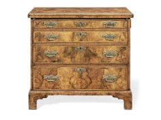 A George I walnut crossbanded and feather banded bachelor's chest