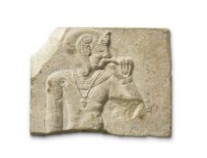 An Egyptian limestone sculptor's model with Harpocrates