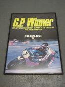 A large 'GP Winner' Suzuki advertising poster