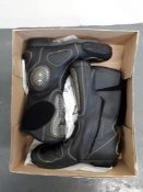 A pair of Dainese motorcycle boots