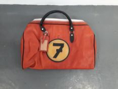 A leather holdall bag