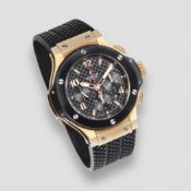 Hublot. An 18K rose gold, black ceramic and titanium automatic calendar chronograph wristwatch B...