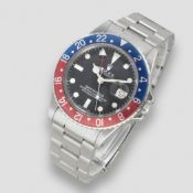 Rolex. A stainless steel automatic calendar bracelet watch with dual time zone GMT Master 'Pepsi...