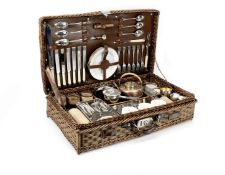 A wicker-cased picnic set for six persons by Finnigans, circa 1909,