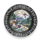 A 19th century Limoges enamel charger decorated with a scene of Artemis and Apollo killing the ch...