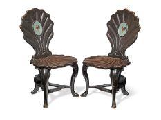 A pair of George II mahogany hall chairs (2)