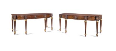 A pair of Regency mahogany and parcel gilt serving tables possibly Scottish (2)