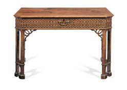 A George III mahogany writing table after a design by Thomas Chippendale