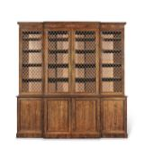 A Regency rosewood and brass mounted breakfront bookcase