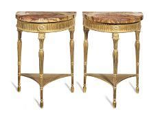 A pair of George III giltwood demi-lune pier tables of small proportions (2)