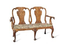 A George II carved walnut double chairback settee