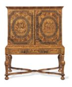 A Charles II oyster veneered olivewood, rosewood, ebony, stained bone and marquetry cabinet on a ...