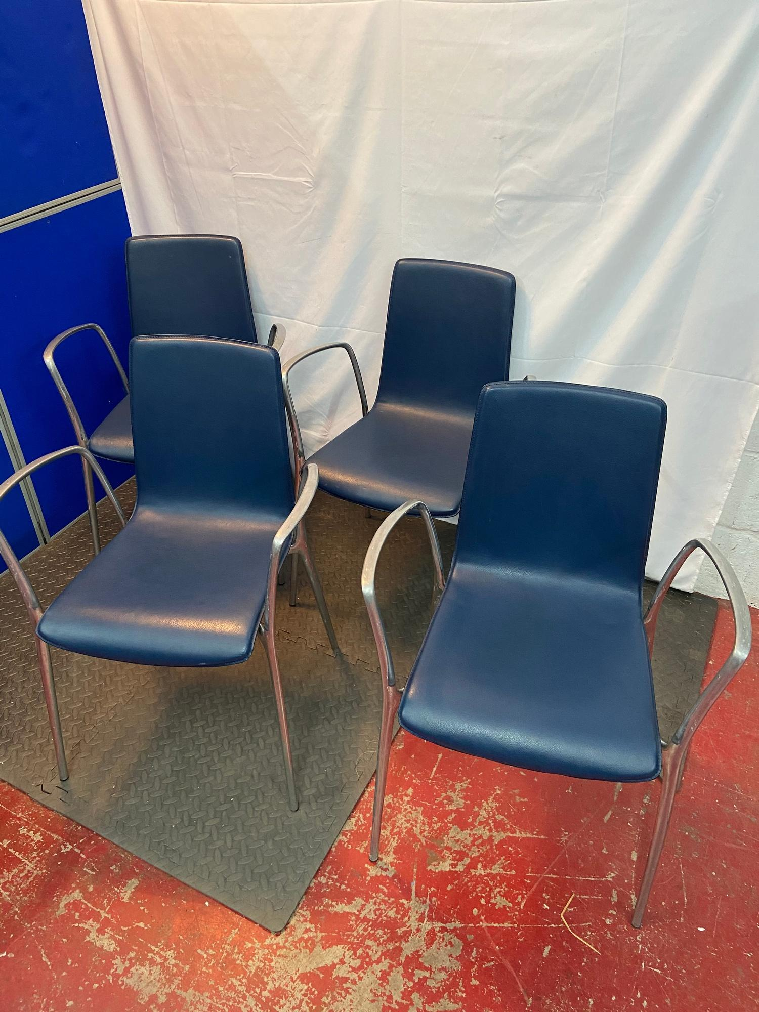 Lot 235 - A Set of four Spanish designer Akaba dining chairs designed by Jorge Pensi. Blue leather material