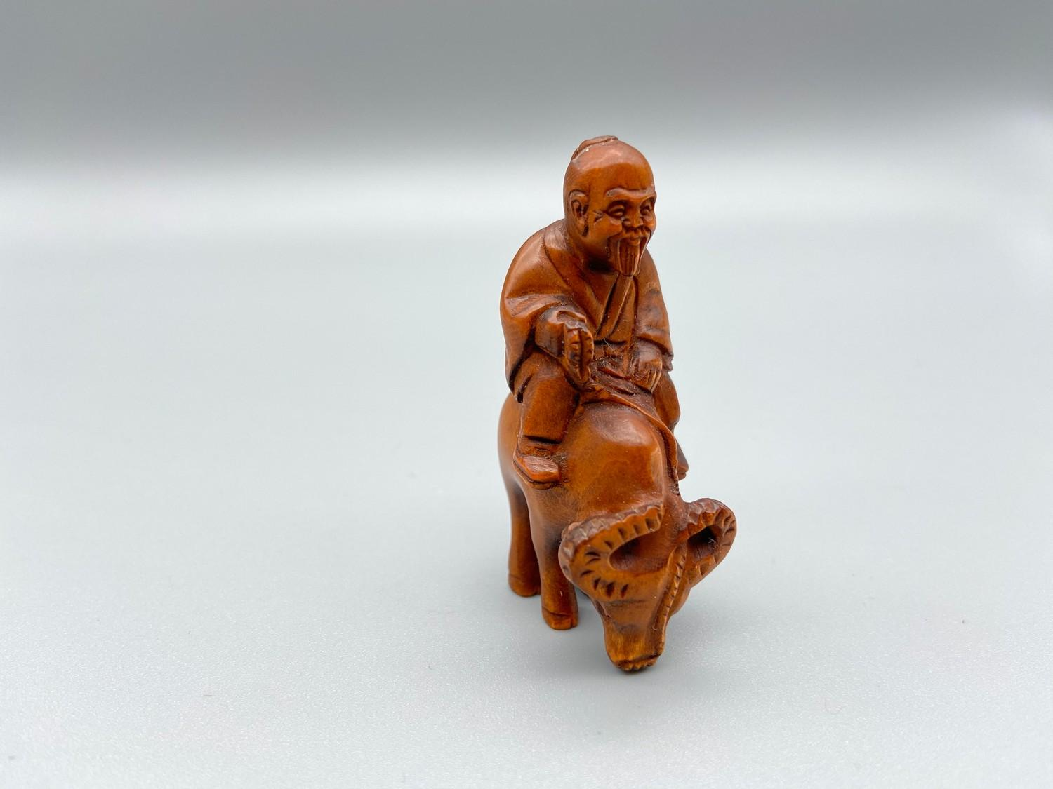 Lot 41J - Japanese hand carved netsuke of a gentleman riding an ox, signed by the artist [5.2cm]