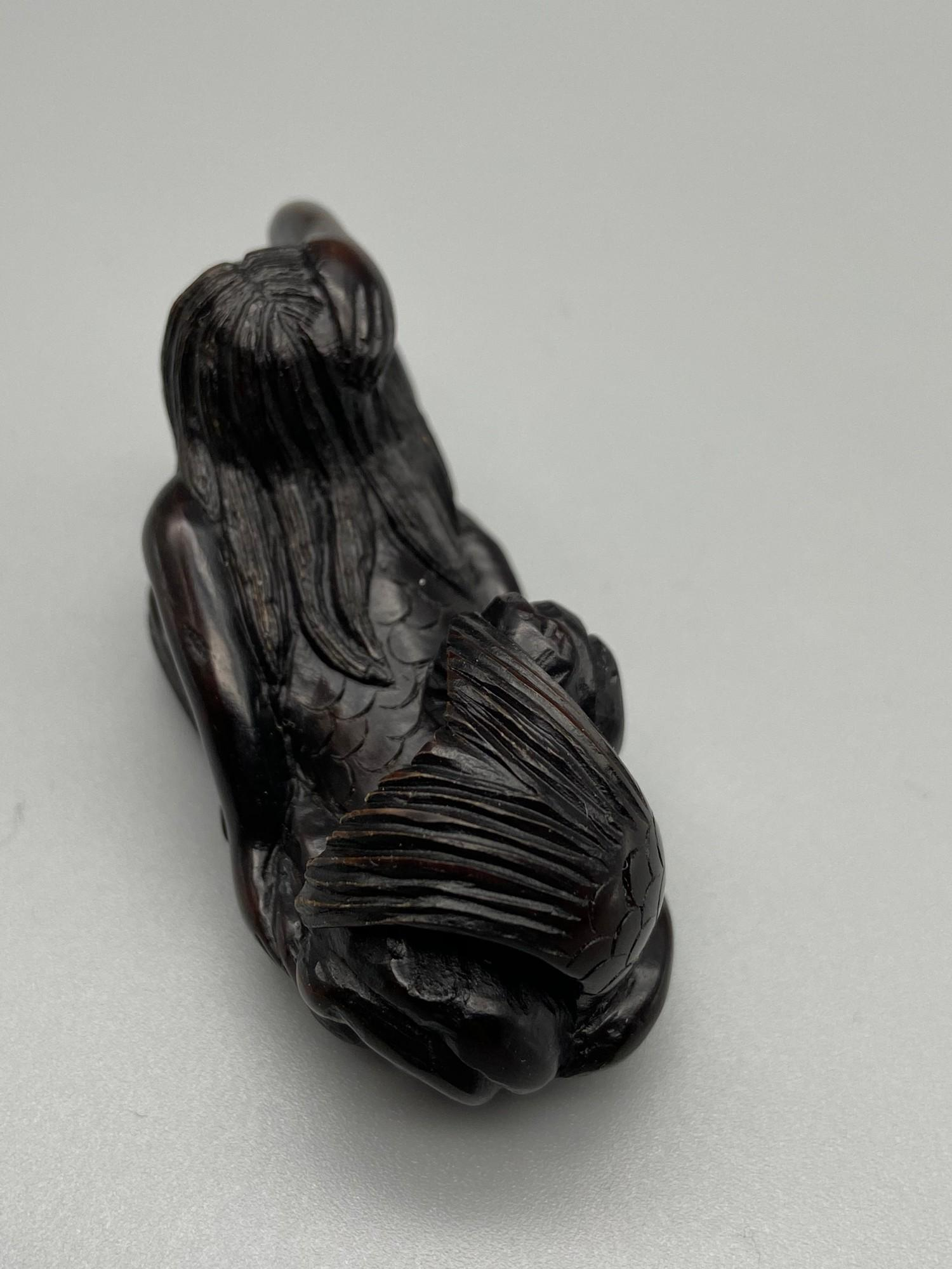 Lot 54J - Japanese hand carved netsuke of a half nude mermaid, signed by the artist [6cm in length]