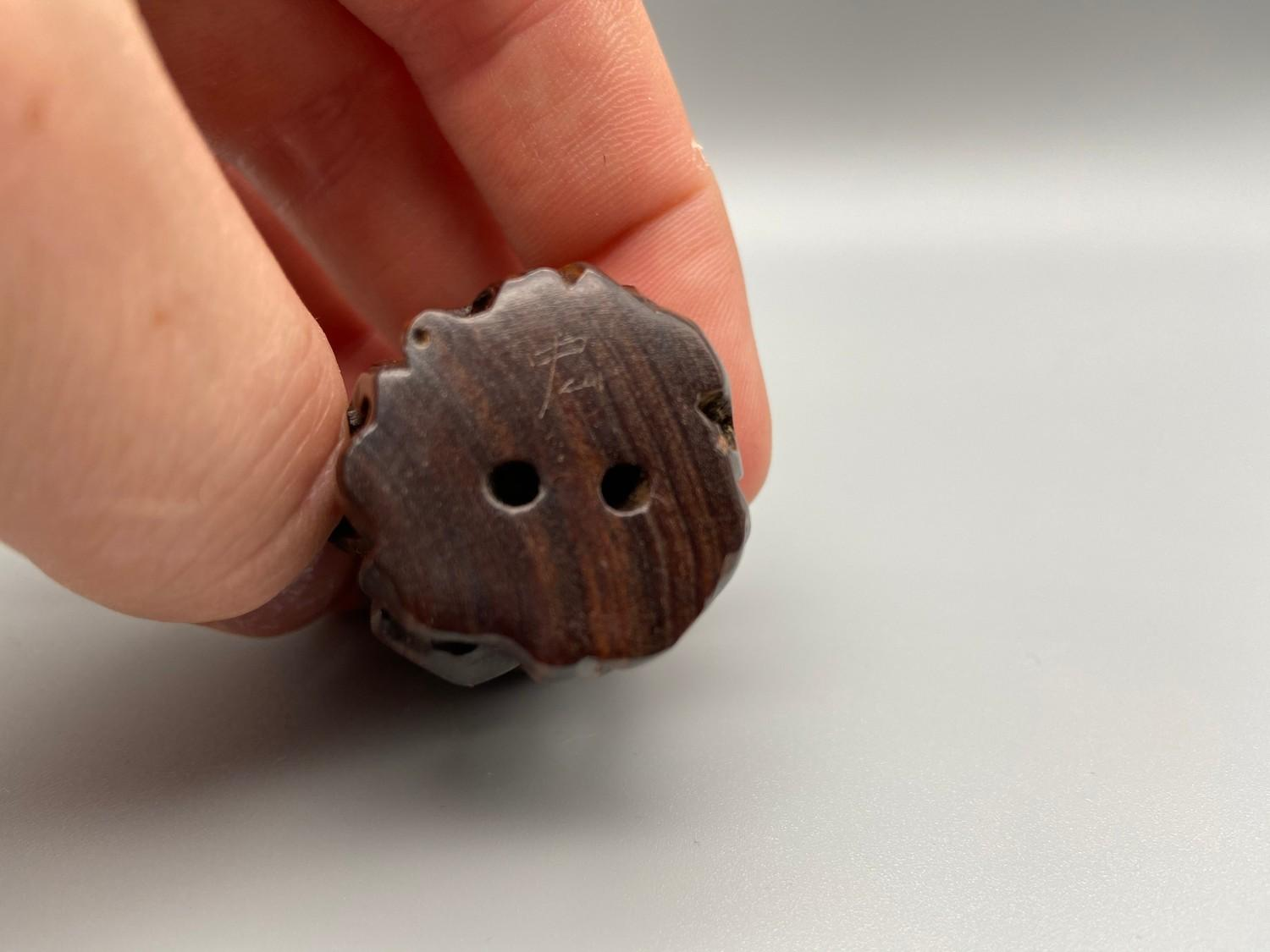 Lot 44J - Japanese hand carved netsuke of an Ox detailed with black bead eyes, signed by the artist [5cm]