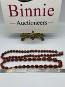 A Vintage amber bead necklace together with an agate bead necklace