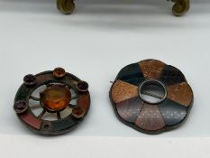 A Lot of two antique Scottish Agate brooches. Possible silver mounts. One As found. Missing agate