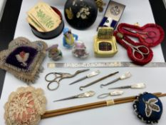A Selection of collectable sewing items which includes three porcelain pin cushion ladies, Various