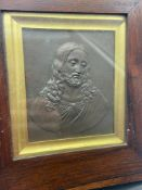 A 18th/ 19th century raised relief Jesus plaque. Fitted within a Wooden frame [24.5x23cm frame]