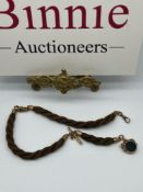 A Victorian 9ct gold and Albert watch chain made with Braided hair and detailed with a T-Bar and