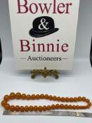 A Vintage Egg Yoke amber graduating bead necklace [Weighs 68Grams] [56cm length]
