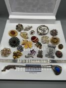 A Quantity of various vintage brooches which also includes Edinburgh Transport Conductor cap
