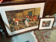 Two framed antique style prints of people celebrating and dining.