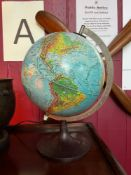 A vintage light up desk globe designed on a bakelite stand. [37cm in height]