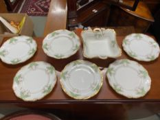 A Beautiful set of Maple & Co London Art Nouveau dinner service plates, tureen and tazza.