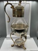 A Vintage F.B Rodgers Silver Company silver plated stand and claret jug.